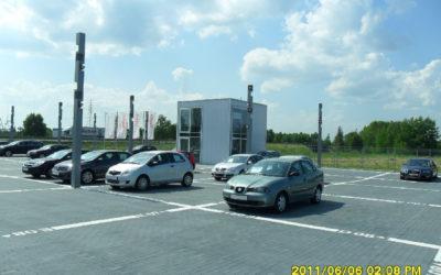 Parkingi przy salonie samochodowym Audi wraz z budynkiem reklamowo-biurowym
